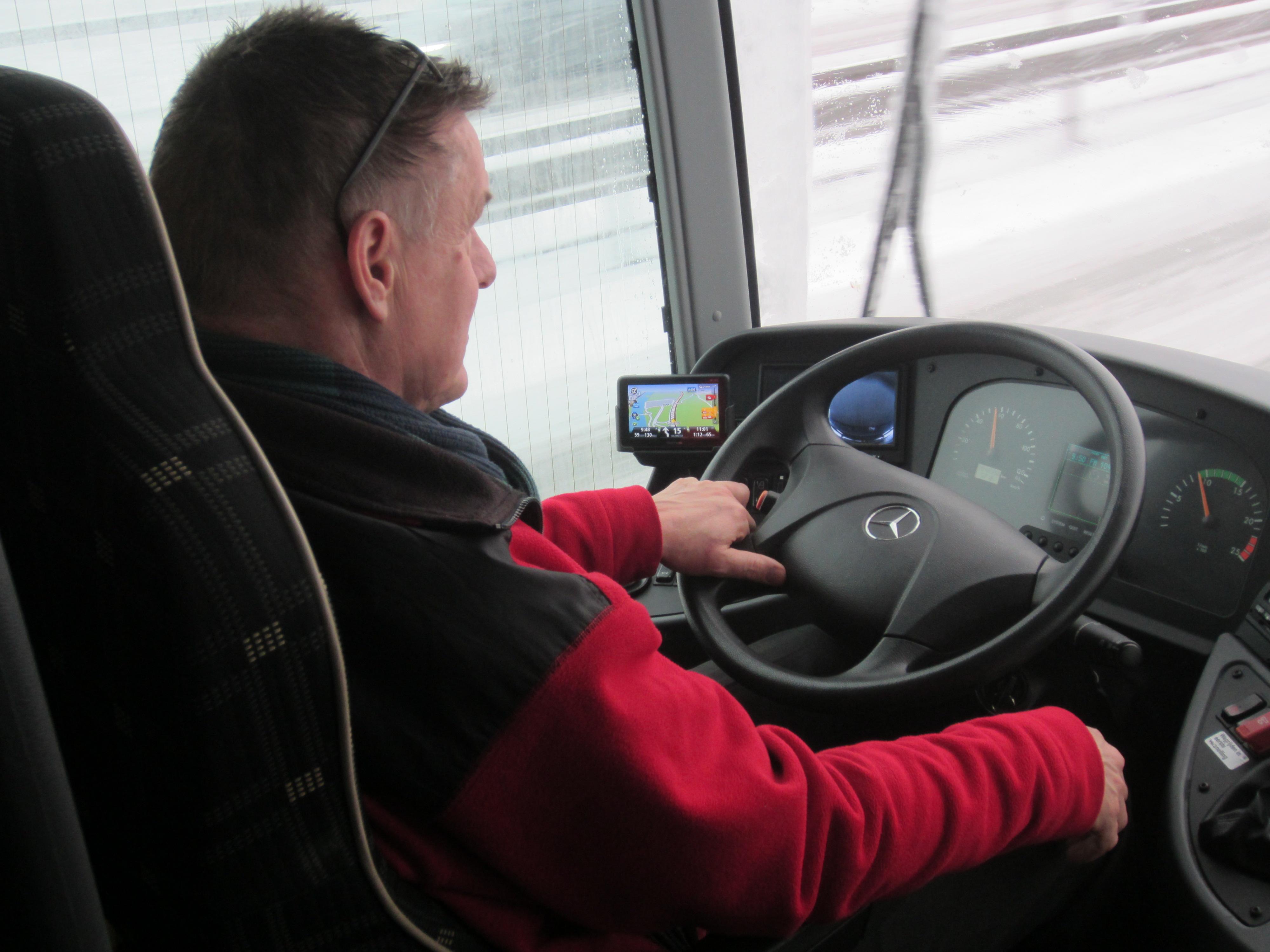 John aan het stuur